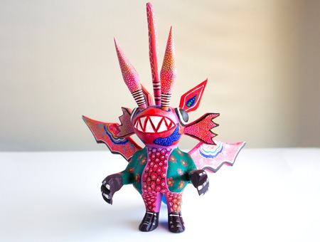 Alebrije monster figure on white surface isolated