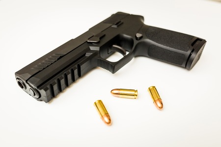 Handgun with ammo rounds and smoke coming out after a shoot 스톡 콘텐츠