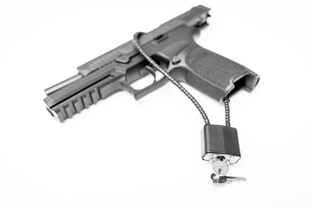 Locked disarmed and secured handgun on isolated white background 版權商用圖片