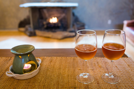 Beer glasses with aroma lamp romantic time at fireplace indoor