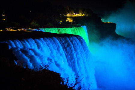 NIagara falls illuminated with color lights at night