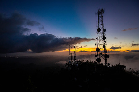 Telecommunication transmitting tower at dawn on top mountain Imagens - 114706825