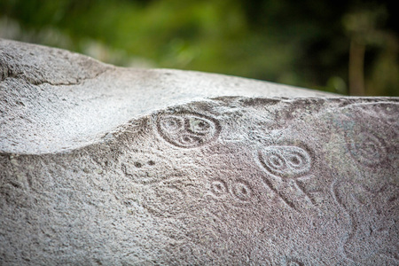 Ancient carved figures Piedra Escrita in Jayuya Puerto Rico
