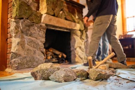 Decorating fireplace with rocks old vintage design men at work