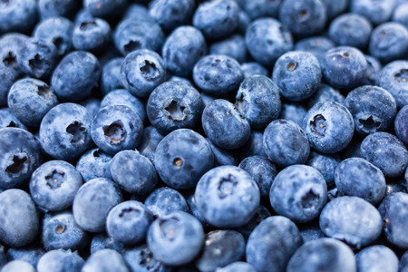 Close up fresh blueberries grouped macro background