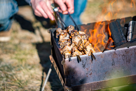 Cooking tasty meat barbecue open fire close up Stock Photo