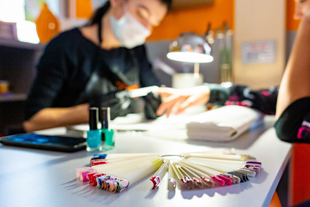 Performing nails manicure at beauty saloon close up isolated Stock Photo