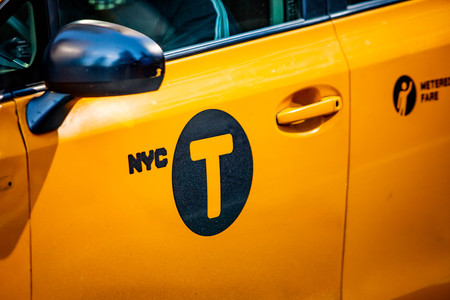 Yellow cab door sign in New York, NY, USA