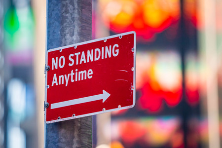No Standing Anytime street sign in city