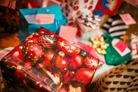 Christmas and New Year gift boxes wrapped under the tree