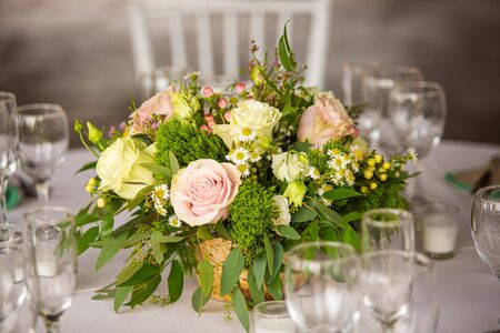 Event decoration with flowers at indoor ceremony summer day Reklamní fotografie