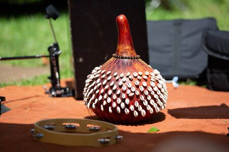 SHekere authentic african instrument outdoor shaker at day unique