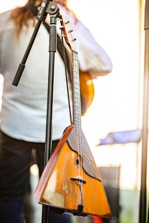 Vintage babalaika musical instrument on concert day performance Stockfoto