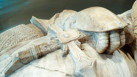Old marble knight symbol armor with sword close up
