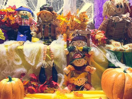 Halloween screen decorations with dolls and pumpkins fall harvest setup