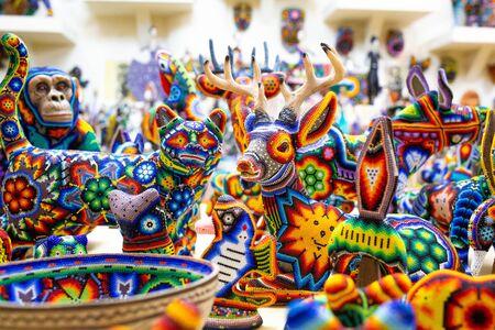 Traditional huichol bead ornament figures mexican culture Foto de archivo