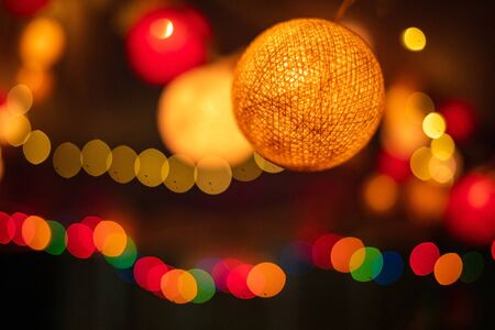Abstract blurred of orange and red glittering shine bulbs lights background bokeh