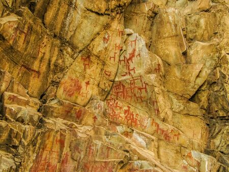 Ancient tribal cave drawings of animals in Peru outside