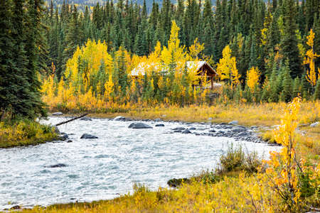 Scenic view of a house at Savage river in Denali national park at fall during sunset