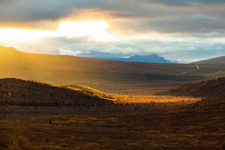 Scenic sunrise at Denali national park taiga mountains at fall