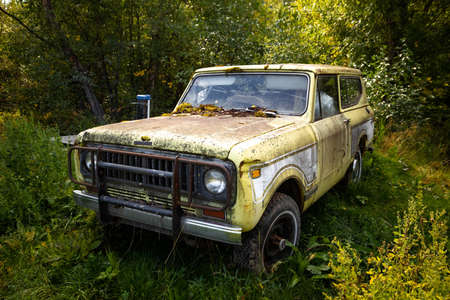 Classic old rusty 4x4 adventure truck in the forest