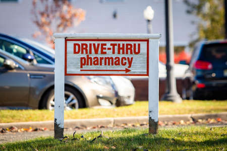 Drive-through pharmacy outdoor sign at sunny day to prevent contact