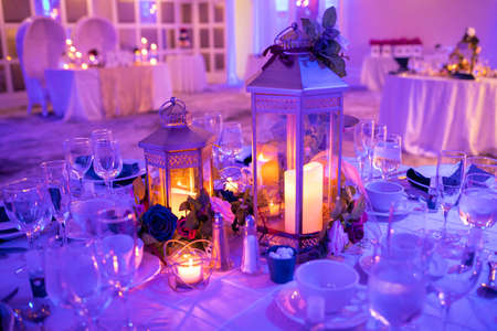 Romantic table setup for special event with candles indoor Banco de Imagens