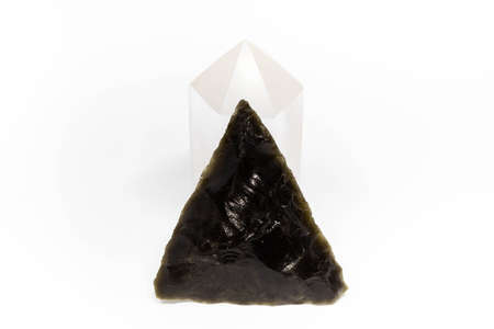 Stone arrow head on a quartz powerful amulet for rituals isolated