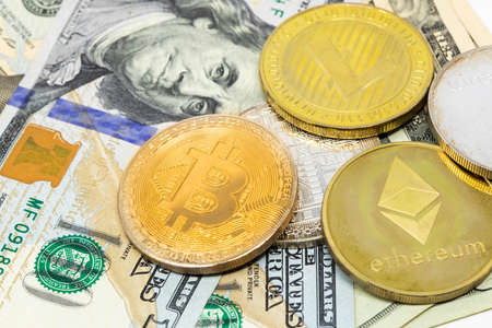 Bitcoin crypto currency on dollar notes close up new currency symbol