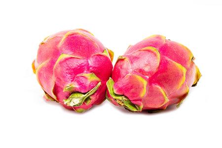 Fresh pair of whole dragonfruit isolated on white background close up