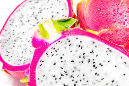 Fresh whole and sliced dragonfruit isolated on white background close up macro Banco de Imagens
