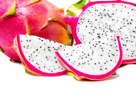 Fresh whole and sliced dragonfruit isolated on white background close up