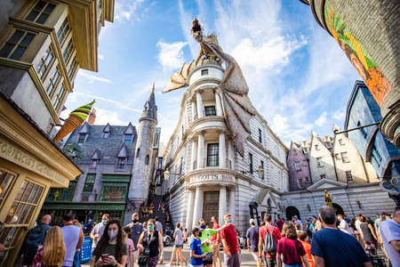 Orlando, USA - Feb. 12, 2021: Fire breathing dragon on top of Gringotts bank at Harry Potter World Éditoriale