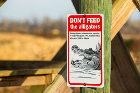 Do not feed alligators warning sign outdoors