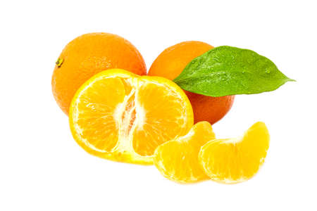 Group of whole cute and sliced mandarines with green leafs on white background