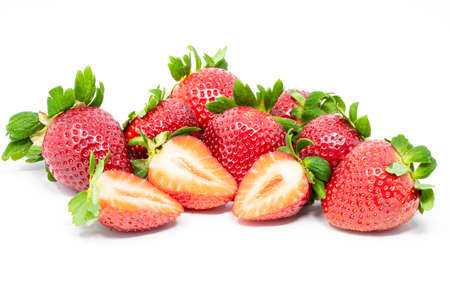 Large group of fresh retouched perfect strawberries whole and cut on isolated white background close up Standard-Bild
