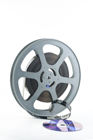 16mm film on reel making its way under DVD simulating film to DVD transfer photo