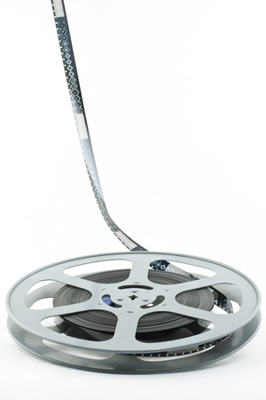 16 mm film reel on white background photo