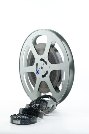 film production: 16mm film reel on white background
