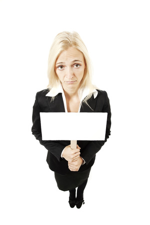 humiliated: Young businesswoman holding transparent on white background Stock Photo