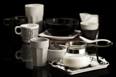 dishware: Table set with black and white dishware