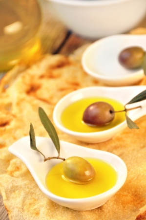 olives with extra virgin olive oil  Stock Photo - 17401319