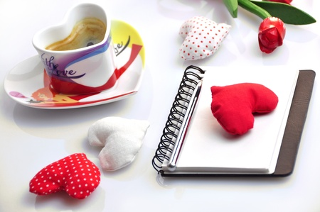 valentine diary with cloth hearts and cup of coffee