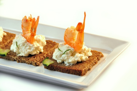 canapes rye bread with ricotta cheese and shrimps