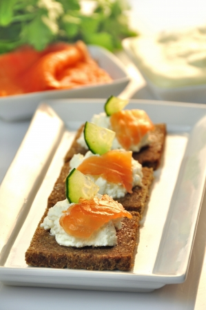 canapes rye bread with ricotta cheese and smoked salmon Stock Photo - 17697982