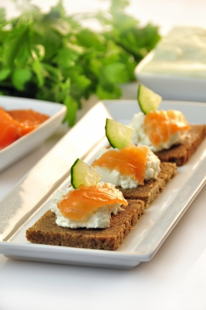 canapes rye bread with ricotta cheese and smoked salmon Stock Photo - 17697987