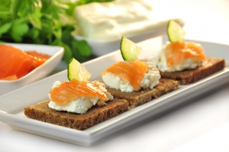canapes rye bread with ricotta cheese and smoked salmon Stock Photo - 17697980