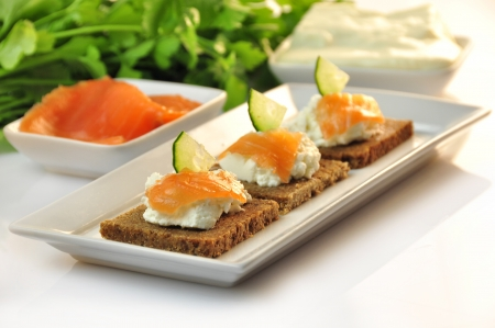 canapes rye bread with ricotta cheese and smoked salmon