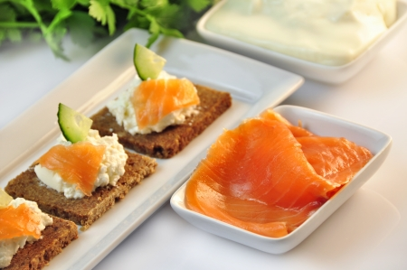 canapes rye bread with ricotta cheese and smoked salmon Stock Photo - 17697981