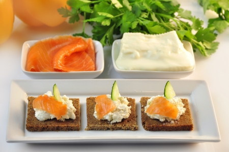 canapes rye bread with ricotta cheese and smoked salmon Stock Photo - 17697991